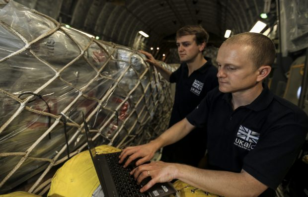 DFID Humanitarian Advisors check humanitarian aid supplies on board an RAF C-17 aircraft. Picture: Sgt Neil Bryden RAF