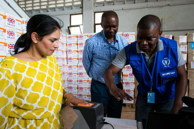 Staff from the United Nations World Food Programme demonstrate a biometric ID system used to track the distribution of food aid, to International Development Secretary Priti Patel in Mogadishu, Somalia. Picture: WFP/Kabir Dhanji