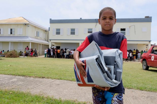 Boy with UK aid shelter kit