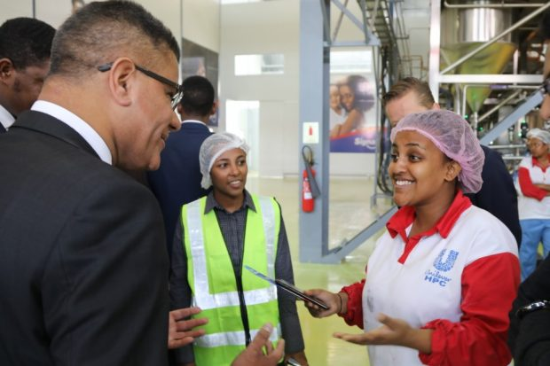 Picture showing Alok Sharma in Ethiopia with Unilever factory workers Bethlehem Tesfaye and Mieraf Tesfaye