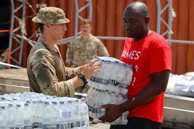 A British military Humanitarian and Disaster Relief (HADR) team from RFA Mounts Bay delivering food, water and emergency shelter kits on the island of Great Abaco in the Bahamas, as part of the UK's response to Hurricane Dorian.